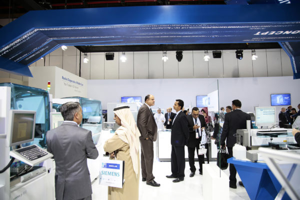 OH37 Arab Health Hanging screens booth design customer interaction